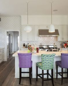White kitchen, colourful chairs