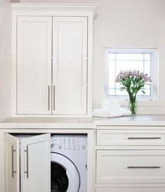 Laundry Room....classic laundry with bi-fold door to conceal appliances