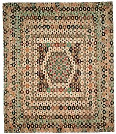 """The Mary Prince Mosaic Coverlet Made from long hexagons in plain and printed cottons and linen. Although the coverlet is signed and dated """"Mary Prince 1803"""", some of the fabrics suggest the coverlet may have been made around 1815."""