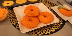 CHEETOS-CRUSTED MAC N CHEESE DONUTS — INGREDIENTS: Prepared mac and cheese Sriracha One egg, beaten (for egg wash) Crumbled CheetosHOW TO: 1. Mix prepared mac and cheese (the cheesier the better!) with Sriracha (to your desired intensity heat) into donut molds and inform the audience to freeze for a few hours. 2. Pull them out of the freezer and remove the mac n cheese from the molds. 3. Dip them into egg wash, and dredge in crushed up Cheetos, and repeat! 4. Then you fry them on low heat…