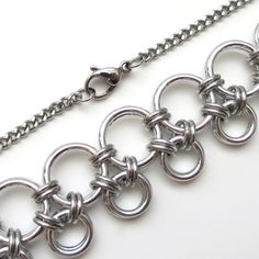 This simple chainmaille necklace would look beautiful on women of all ages. The fresh and elegant style would look fabulous dressed up or down.OverviewMaterials: aluminum jump rings, stainless steel curb chain, stainless steel lobster claw claspNecklace length: 18 inchesMeasurements: