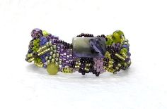 Free Form Peyote Stitch Beaded Bracelet Emotional Healing by Cheri C Meyer, $125.00.  Emotional healing begins with charoite and fears are replaced with courage and self-esteem, spiritual transformation begins. With the release of negative emotions, it is believed that negative spirits or entities exit the body.