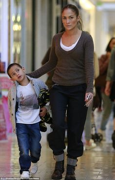 Mum duty: Jennifer Lopez took her twins on a shopping trip at a mall in Westwood, California on Sunday