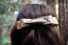 DIY Snakeskin Hair Bow  STYLE, TRENDING      Cute hair accessories are easy to come by, but there's nothing more satisfying than making a one of a kind accessory for yourself. Armed with some awesome snakeskin trim from M Trimming, we DIYed this classic hair bow. On a lazy day, simply throw it in your hair and you'll instantly look chic. Follow the directions below to learn how to make your own.   Click for StyleNotes →