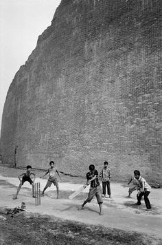 Abbas  BANGLADESH. Dhaka. Children play cricket by the monument commemorating Bengali intellectuals who were massacred by Pakistani militia on December 14, 1971, two days before the surrender of the Pakistani forces to the Indian army, making official the secession of Bangladesh.