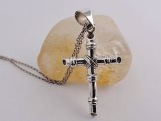 Sterling silver cross / crucifix. Intricate hand by SuloJewellery