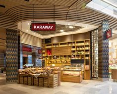 Designed by ico design  There is strong emphasis on the use of natural materials throughout the store, from brown-paper carrier bags, to linen staff aprons and handwritten price tags
