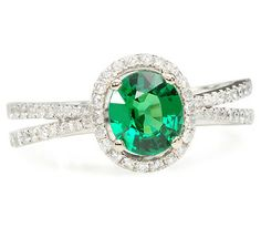 1.18 ct Tsavorite & Diamond Ring. In 1974 Tiffany & Co. introduced the tsavorite (tsavolite) to N. America. The rare gem is a species of the green garnet with a fresh radiant green color. The gem is surrounded by sixty-two (62) brilliant cut diamonds. Date: Modern estate.
