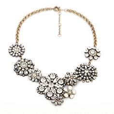 Get ready for spring with this Fit&wit Clear Rhinestone Snow Flower Crystal Resin Statement Fashion Necklace!