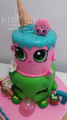 Shopkins cake Vanilla cake & buttercream covered in fondant, all cake toppers are handcrafted made out of fondant