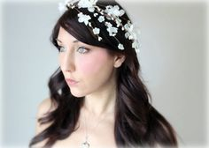 A swirl of white blossoms looks sweet and fresh without seeming childish or dated. Wedding Veil, Wedding Beauty, Our Wedding, Wedding Things, Wedding Dresses, Whimsical Wedding, Floral Headbands, Tiaras And Crowns, Bridal Flowers