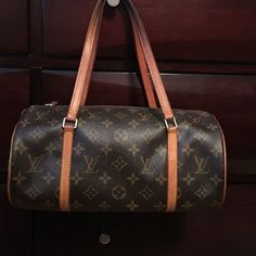 Authentic Louis Vuitton Monogram Papillon 30 Bag Authentic LV Papillon 30 VVN Monogram bag. Comes with Dustbag and Authenticity Cards. Mint condition. Straps have darkened as normal signs of LV wear/authenticity. Purchased at Louis Vuitton inside of Saks. Louis Vuitton Bags Totes