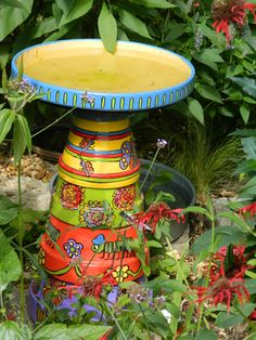 A cool bird bath made with plant pots