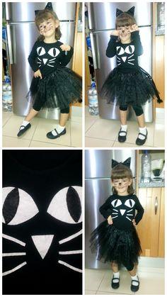 Un tutú negro, camiseta negra decorada con fieltro, orejas y cola de gato caseras... y ¡ tachán ! una linda gatita.