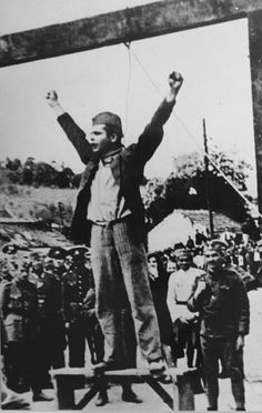"Standing beneath the gallows where he will be hanged momentarily, Stjepan Filipovic, commander of the Tomnasko-Kolubarski partisan detachment, calls upon the people of Serbia to fight the traitors of the Serbian people. Source: O'Keeffe, Sarah, ""Filipovic's Valiant Last Stand: The Defiant One,"" n.d. (22 August 2002)."
