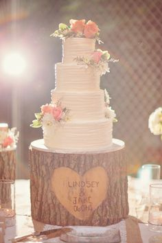 tree stump cake stand is adorable; with clusters of fresh flowers on the cake, photo by Wright Photographs #watters #rustic #wedding #cake