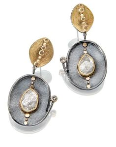 Diamond slices and 5 pt diamonds in gold and oxidized silver earrings. http://sydneylynch.com