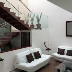 Sala: Salas de estilo moderno por Ambás Arquitectos