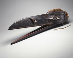 Raven Mask; Kwakwaka'wakw; 1801–1900; Wood, pigment, cedar bark; Collection of the Brooklyn Museum, 15.513.3a-c.