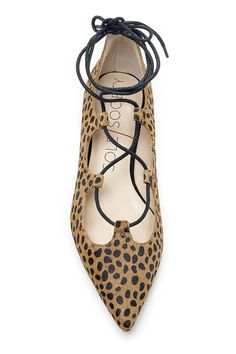 Pointy lace-up flats in cheetah print