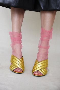 gold and pink shoe and sock combo.