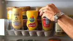 25 Hacks to Organize your Fridge - Store your condiment bottles upside down in egg cartons