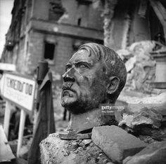 A bust of Adolf Hitler lies amidst the ruins of the Chancellery, Berlin.