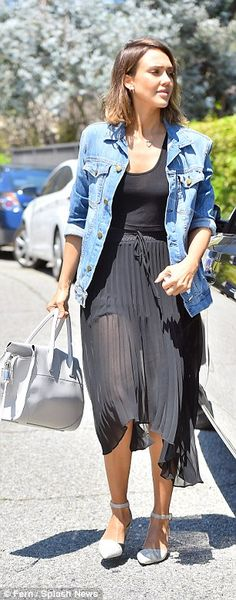 Ready for some serious chilling: On top she wore a matching black crop top under a loose fit denim jacket, with the sleeves rolled up