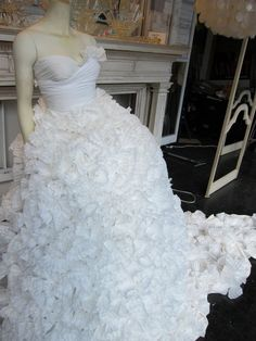 This wedding gown is made entirely of coffee filters. I need a bridal salon just so I can do this as the window display. Love this!