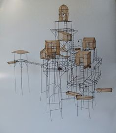 'Village des pêcheurs de graines' (Fishing Village Seed) (2005) by Paris-based French artist Isabelle Bonte. Wire, tinted tarlatane (loosely woven Indian cotton) & seeds. 52 x 43 x 64 cm. via the artist's site