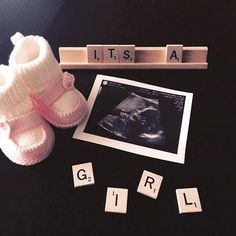 "Gender Reveal/Announcment ""It's a girl!"" using sonogram and scrabble pieces."