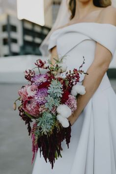 cascading berry-toned bridal bouquet with proteas and amaranth Modern Wedding Theme, Floral Wedding, Wedding Flowers, Cascading Bridal Bouquets, Bride Bouquets, Warehouse Wedding, November Wedding, Wedding Inspiration, Wedding Ideas
