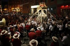 Members of the Fishermans Club and their families carry the statue of the Madonna through North End streets during the finale of the Fishermans Feast Sunday night.
