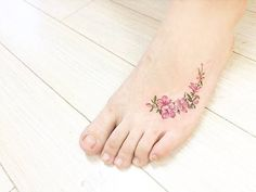 Apple blossom - 15 Of The Smallest, Most Tasteful Flower Tattoos