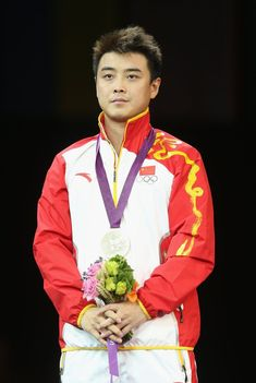 ilver medalist Wang Hao of China poses on the podium during the medal ceremony during the medal ceremony for the Men's Singles Table Tennis on Day 6 of the London 2012 Olympic Games at ExCeL on August 2, 2012 in London, England. (Photo by Feng Li/Getty Images)