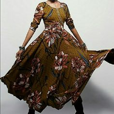 NWT*Free People* First Kiss,Goldenrod Combo Dress Absolutely stunning unique dress! Very attractive back closing, with material covered buttons ,long sleeve, soft floating fabric. Incredible color and pattern combination . Runs big, this is size M but it is big on me and I am size 8 / M. Price is firm unless it is bundled. Free People Dresses Maxi