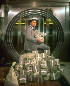 Muhammad Ali with a little cash. This is from the twitter feed @si_vault, and probably won't be the last pic we post from there. Some dope old school Sports Illustrated pics are always welcome.