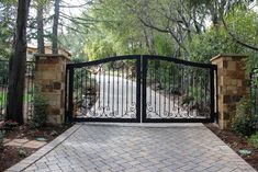 Automatic ornamental iron driveway gates mediterranean-landscape
