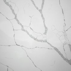 This is the Calacutta Statuario. The Calacutta Statuario is a pure white with large grey marble effect quartz. We can colour match the veins on upstands, splashbacks and end panels for a dramatic and tasteful look.