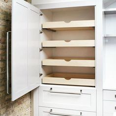 If you don't have room in your kitchen for a walk in pantry...consider a pantry cabinet similar to this (not ours, source unknown). Easy access, keeps all of your items in one place the the sliding drawers make it easy to reach everything! . . . #rangecustomhomes #customcabinets #customhome #mnhomes #mnrealestate #mnbuilder #newhome #kitchen #kitchendesign #designers #interiordesigners #interiordesignideas #whitecabinets #dreamkitchen