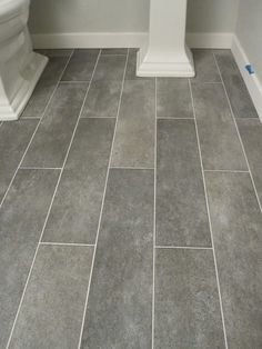 Wide plank tile for bathroom. Great grey color! Great option if you can't do wood throughout.