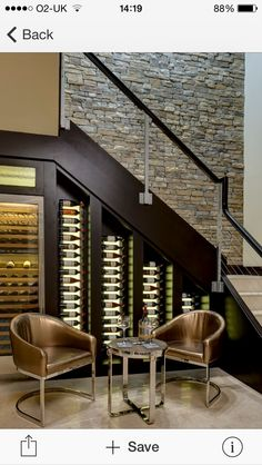 Wine cellar plus textured rock wall down to bsmt