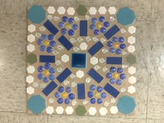 Large mosaic stepping stone created by adults with intellectual and developmental disabilities.