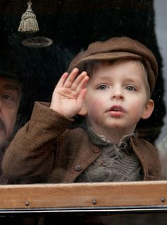 "One last wave goodbye from Charlie to his mother, Ethel. He doesn't know it's the last one. ""as I say goodbye to you...""  Downton Abbey"