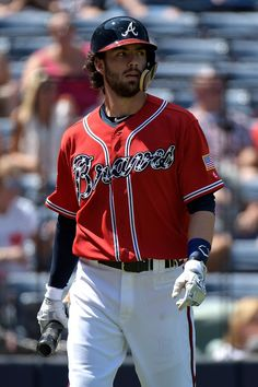Dansby Swanson Photos Photos - Dansby Swanson #2 of the Atlanta Braves walks back to the dugout after striking out against Seth Lugo #67 of the New York Mets in the second inning of the game at Turner Field on September 11, 2016 in Atlanta, Georgia. - New York Mets v Atlanta Braves