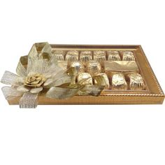 Raksha Bandhan Gold Tray Golden platter with golden wrapped chocolates makes an ideal gift for this festive season. Rs 950/- http://www.tajonline.com/rakhi-gifts/product/r4558/raksha-bandhan-gold-tray/?aff=pint2014/