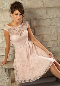 Romantic Knee Length Lace Bridesmaid Dress Designed by Madeline Gardner. Zipper back. Shown in Blush.