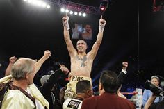 Former lightweight champion boxer Brandon Rios (C) of the U.S. celebrates after defeating Richard Abril of Cuba in a fight for the vacant WBA lightweight title at the Mandalay Bay Events Center in Las Vegas, Nevada April 14, 2012.
