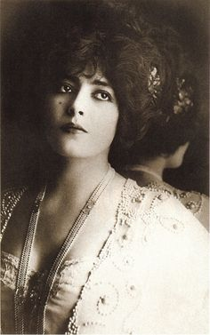 """Geneviève Lantelme (1882-1911)  Best known as the mistress of Alfred Edwards. Misia, Edwards' wife, was extremely jealous of her husband's mistress, and said in her memoirs """"I had contrived to get a photograph of Lantelme; it adorned my dressing-table, and I made desperate efforts to look like her, dress my hair in the same way, wear the same clothes."""" Marcel Proust used this as the model for Gilberte's jealousy of Rachel and Saint-Loup in À la recherche du temps perdu."""