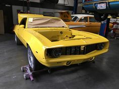 """69 Camaro front view with the grille, Truck-lite 27270C LED 7"""" headlights, and painted front bumper installed, taken May 31, 2016."""